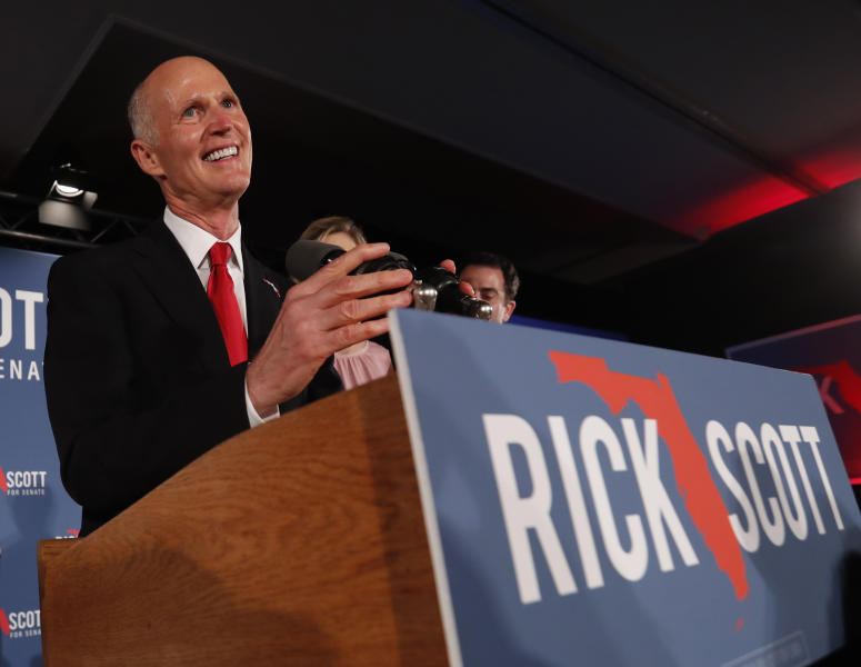 Republican Senate candidate Rick Scott smiles as he speaks to supporters at an election watch party, Wednesday, Nov. 7, 2018, in Naples, Fla. (AP Photo/Wilfredo Lee)