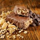 """<p>Like many processed foods, packaged protein bars are often packed with various forms of sugar (beet syrup, brown rice syrup, cane syrup), excess fats (palm kernel oil, sunflower oil), and artificial colors and flavors. Plus, protein bars sometimes contain gas-causing compounds like <a href=""""https://www.ncbi.nlm.nih.gov/pmc/articles/PMC4819855/"""" rel=""""nofollow noopener"""" target=""""_blank"""" data-ylk=""""slk:sucralose"""" class=""""link rapid-noclick-resp"""">sucralose</a> (a sugar substitute) and <a href=""""https://www.ncbi.nlm.nih.gov/pubmed/20497775"""" rel=""""nofollow noopener"""" target=""""_blank"""" data-ylk=""""slk:chicory root"""" class=""""link rapid-noclick-resp"""">chicory root</a> (a fiber additive). </p><p>""""I've found that a bar just doesn't register the same as a meal for me, and I'm hungry again shortly after no matter how many grams of protein or fiber it says are on the label,"""" says Jess Cording, R.D. If you're still set on snacking on a post-workout protein bar, Brissette suggests looking for a """"clean label"""" that lists real food ingredients, not ones you can't recognize.</p>"""