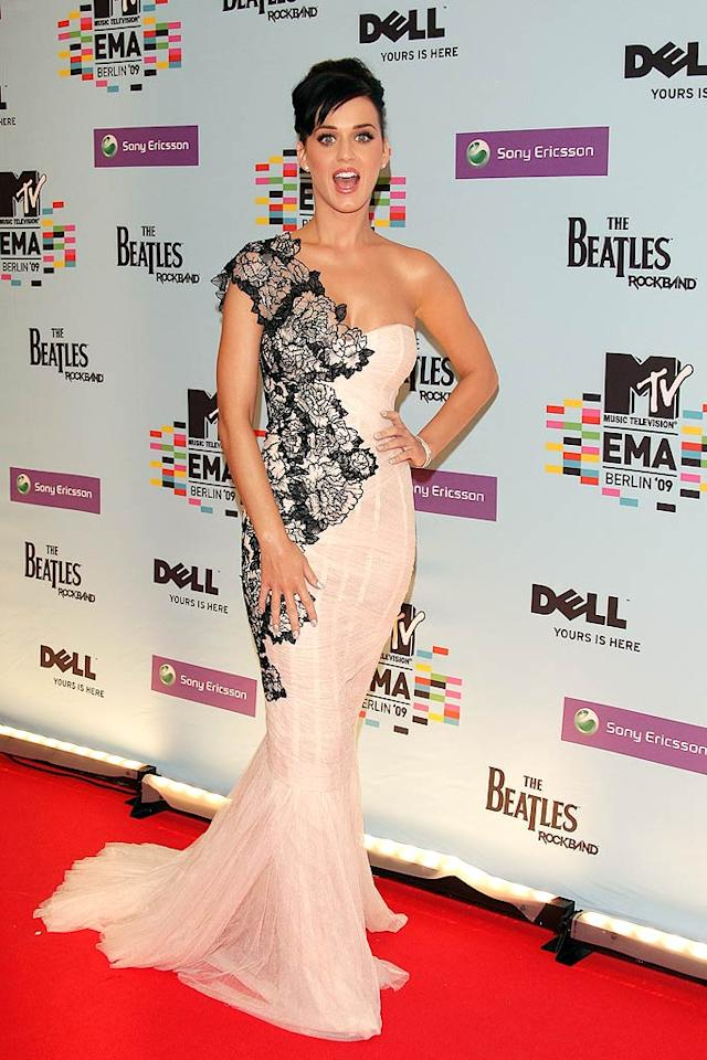 """Host Katy Perry rocked a beautiful floral, one-shoulder Marchesa gown and an updo for the EMAs, which were held in the German capital to mark the 20th anniversary of the fall of the Berlin Wall on November 9. Venturelli/<a href=""""http://www.wireimage.com"""" target=""""new"""">WireImage.com</a> - November 5, 2009"""