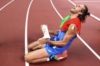Gold medalist Gianmarco Tamberi of Italy celebrates on the track after jointly winning the final of the men's high jump at the 2020 Summer Olympics, Sunday, Aug. 1, 2021, in Tokyo, Japan. (Cameron Spencer/Pool Photo via AP)