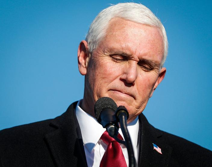 Former Vice President Mike Pence gives a speech to a small crowd on Wednesday, Jan. 20, 2021 at Columbus Municipal Airport in Columbus, Ind.