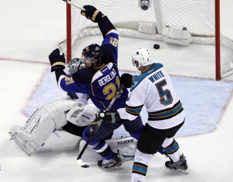 St. Louis Blues' Patrik Berglund (21), of Sweden, celebrates as a shot by teammate David Perron (not shown) scores past San Jose Sharks goalie Antti Niemi, of Finland, and Colin White (5)  during the third period in Game 5 of an NHL first-round playoff series hockey game on Saturday, April 21, 2012, in St. Louis. The Blues won 3-1 and won the series 4-1. (AP Photo/Jeff Roberson)