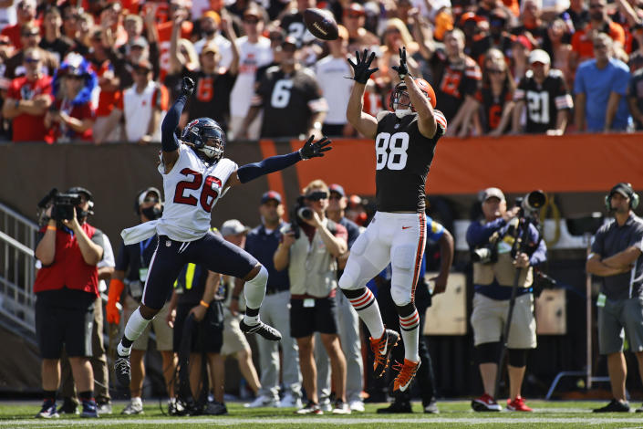 Cleveland Browns tight end Harrison Bryant (88) catches a pass ahead of Houston Texans cornerback Vernon Hargreaves III (26) during the first half of an NFL football game, Sunday, Sept. 19, 2021, in Cleveland. (AP Photo/Ron Schwane)