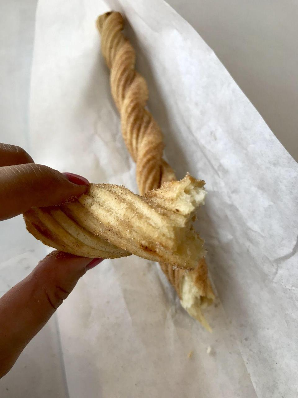 <p>First of all, the churro is CRAZY long, especially for just $1. This one is soft on the inside and fairly crispy on the outside. I wish there was more cinnamon covering it, and I reaaaally wish there was something to dip it in!</p>