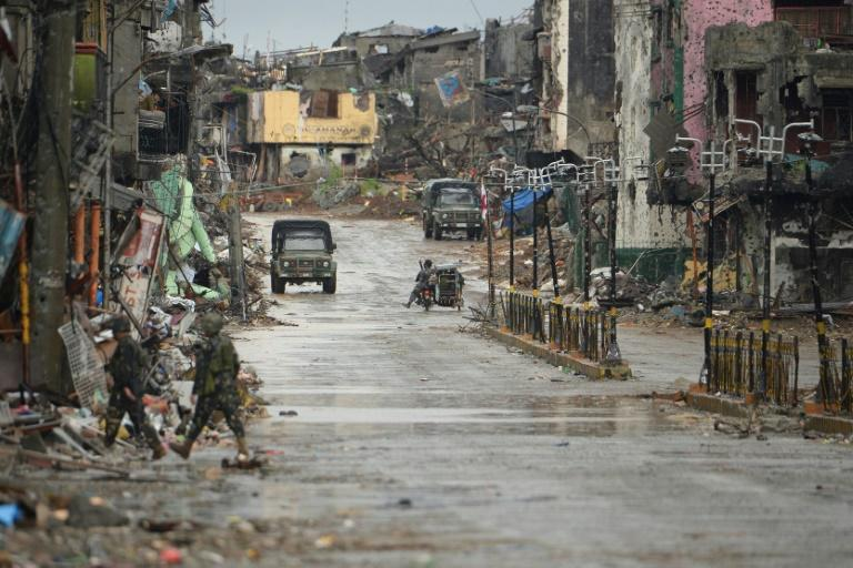 An AFP team in Marawi saw metal shutters and walls pockmarked with bullet holes, pavements piled high with twisted metal and cannibalised cars, and streets strewn with machine-gun slugs