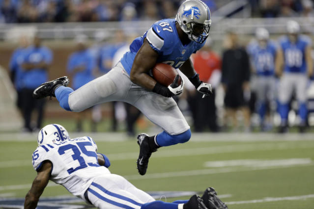 Detroit Lions tight end Brandon Pettigrew (87) leaps over Indianapolis Colts strong safety Joe Lefeged (35) during the second quarter of an NFL football game at Ford Field in Detroit, Sunday, Dec. 2, 2012. (AP Photo/Paul Sancya)
