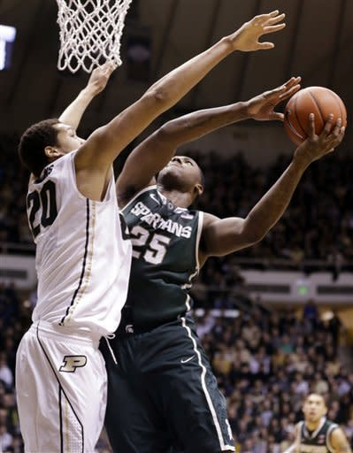 Michigan State center Derrick Nix, right, shoots over Purdue center A.J. Hammons in the first half of an NCAA college basketball game in West Lafayette, Ind., Saturday, Feb. 9, 2013. (AP Photo/Michael Conroy)