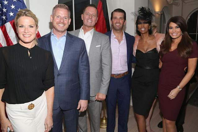 Donald Trump Jr., fourth from left, and Kimberly Guilfoyle, right, attend a May 6 party in New York City. (Photo: Sylvain Gaboury/Patrick McMullan via Getty Images)
