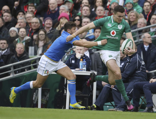 Italy's Marcello Violi, left, tackles Ireland's Jacob Stockdale during the Six Nations rugby union match between Ireland and Italy at the Aviva stadium in Dublin, Ireland, Saturday, Feb. 10, 2018 . (AP Photo/Peter Morrison)