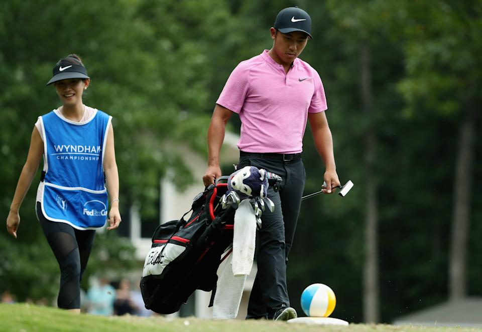 GREENSBORO, NC - AUGUST 18:  C.T. Pan of Taiwan walks the seventh tee with his wife and caddie Michelle Lin during the third round of the Wyndham Championship at Sedgefield Country Club on August 18, 2018 in Greensboro, North Carolina.  (Photo by Streeter Lecka/Getty Images)