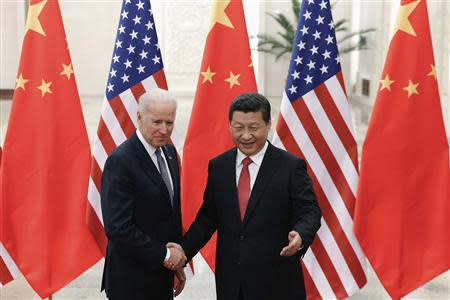Chinese President Xi Jinping (R) shakes hands with U.S. Vice President Joe Biden (L) inside the Great Hall of the People in Beijing December 4, 2013. REUTERS/Lintao Zhang/Pool