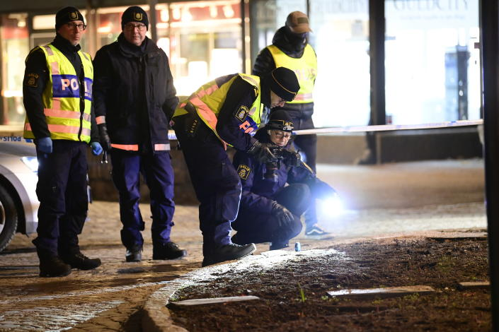 """Police are seen in the area after several people were attacked in Vetlanda, Sweden, Wednesday, March 3, 2021. Swedish police say a man has assaulted at least eight people in a southern Sweden town, and that the case was being investigated as """"a suspected terrorist crime."""" Police said a man in his 20s attacked people in the small town of Vetlanda, about 190 kilometers (118 miles) southeast of Goteborg, Sweden's second largest city. (Mikael Fritzon/TT News Agency via AP)"""