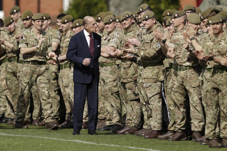 FILE - In this Thursday, March 30, 2017 file photo, Britain's Prince Philip, in his capacity of Colonel, Grenadier Guards, talks with members of the 1st Battalion Grenadier Guards as they applaud the final whistle from the sidelines, of the Manchester Cup inter-company football match at Lille Barracks in Aldershot, England. Buckingham Palace officials say Prince Philip, the husband of Queen Elizabeth II, has died, it was announced on Friday, April 9, 2021. He was 99. Philip spent a month in hospital earlier this year before being released on March 16 to return to Windsor Castle. Philip, also known as the Duke of Edinburgh, married Elizabeth in 1947 and was the longest-serving consort in British history. (AP Photo/Matt Dunham, Pool, File)