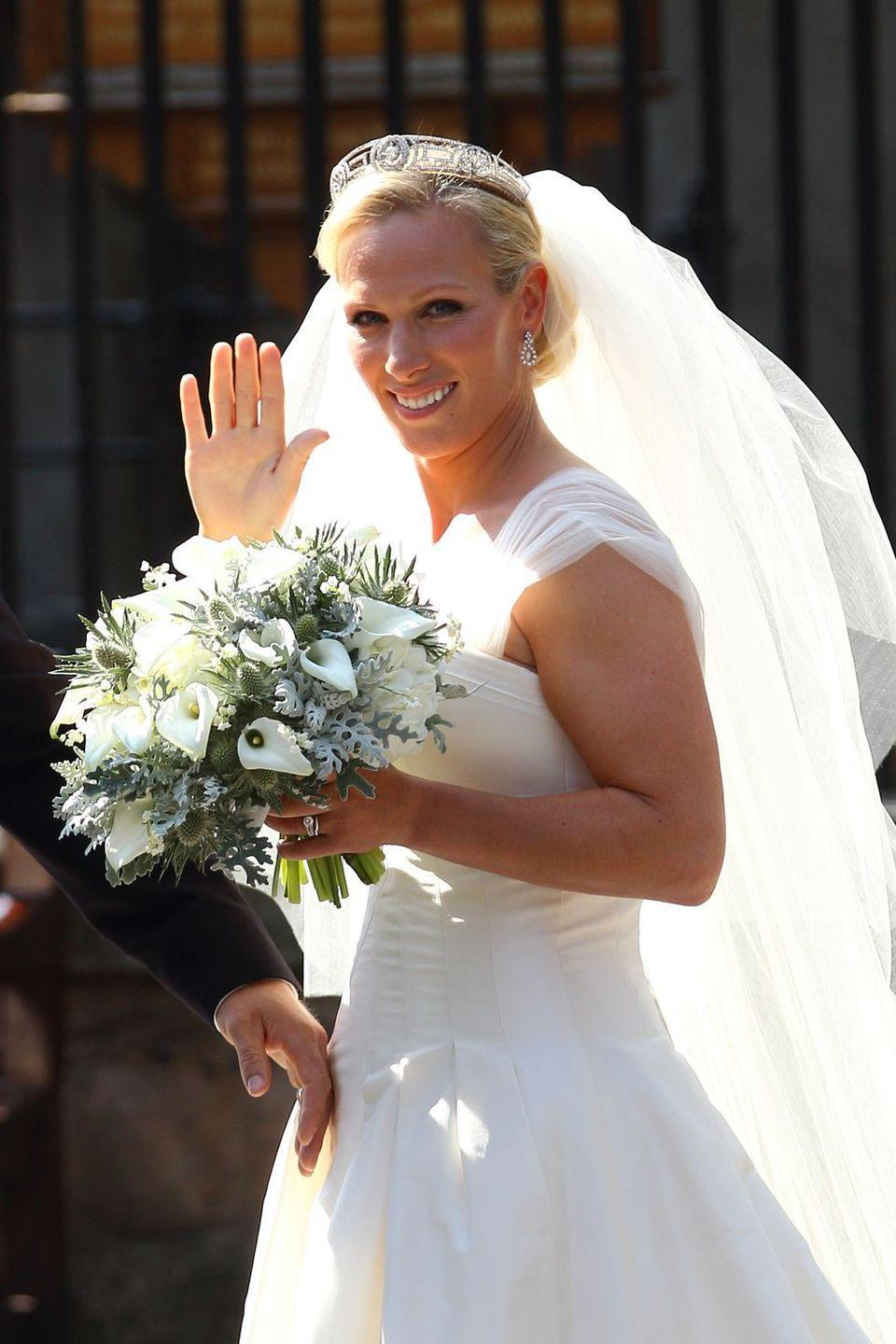"<p><strong>Wedding date: </strong>July 30, 2011</p><p><strong>Wedding tiara: </strong><a href=""https://www.townandcountrymag.com/society/tradition/g19460546/zara-tindall-best-style-moments/"" rel=""nofollow noopener"" target=""_blank"" data-ylk=""slk:Zara wore a Greek key"" class=""link rapid-noclick-resp"">Zara wore a Greek key</a>-patterned tiara. The diadem, which is in Princess Anne's collection and is one of her favorites, once belonged to Prince Philip's mother, Princess Andrew of Greece. It's often called <a href=""http://orderofsplendor.blogspot.com/2011/07/tiara-thursday-meander-tiara.html"" rel=""nofollow noopener"" target=""_blank"" data-ylk=""slk:Princess Andrew's Meander Tiara."" class=""link rapid-noclick-resp"">Princess Andrew's Meander Tiara.</a></p>"