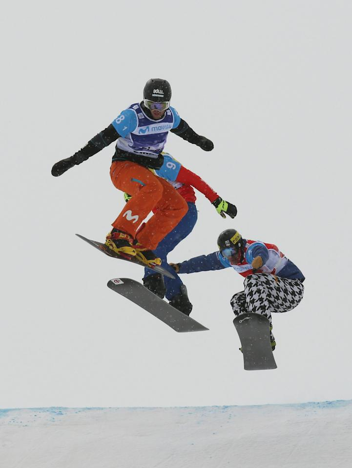 REFILE - CORRECTING IDENTITY OF TWO COMPETITORS Snowboarding - FIS Snowboarding and Freestyle Skiing World Championships - Men's Team Snowboard Cross - Sierra Nevada, Spain - 13/03/17   (L to R) Lucas Eguibar of Spain, Lukas Pachner of Austria and Nick Baumgartner of the U.S. in action during the semi final.   REUTERS/Albert Gea