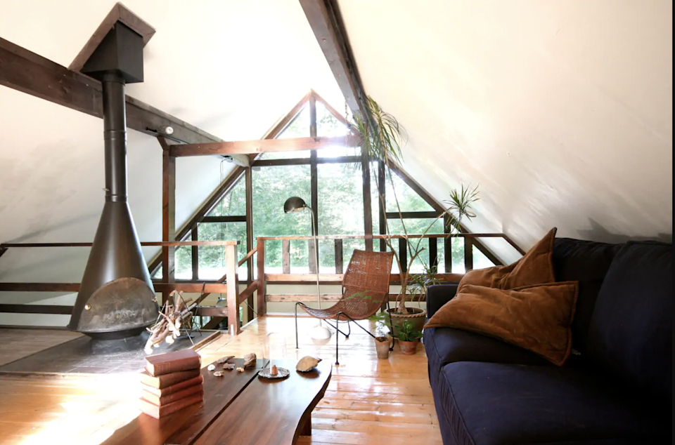 """<h2>The Poconos, Pennsylvania<br></h2><br><strong>Location:</strong> Bushkill, PA<br><strong>Sleeps:</strong> 7<br><strong>Price Per Night:</strong> <a href=""""https://airbnb.pvxt.net/kj4Byd"""" rel=""""nofollow noopener"""" target=""""_blank"""" data-ylk=""""slk:$175"""" class=""""link rapid-noclick-resp"""">$175</a><br><br>""""The Ridge House is a mountain escape located in the heart of the Poconos. On a wooded lot perched on a mountain ridge, the cabin offers spectacular views of the beautiful landscape. As interior designers for our firm, Ridge House Studio, we were sure to curate the design to be truly unique.""""<br><br><h3>Book <a href=""""https://airbnb.pvxt.net/kj4Byd"""" rel=""""nofollow noopener"""" target=""""_blank"""" data-ylk=""""slk:Ridge House Pocono Chalet"""" class=""""link rapid-noclick-resp"""">Ridge House Pocono Chalet</a></h3>"""