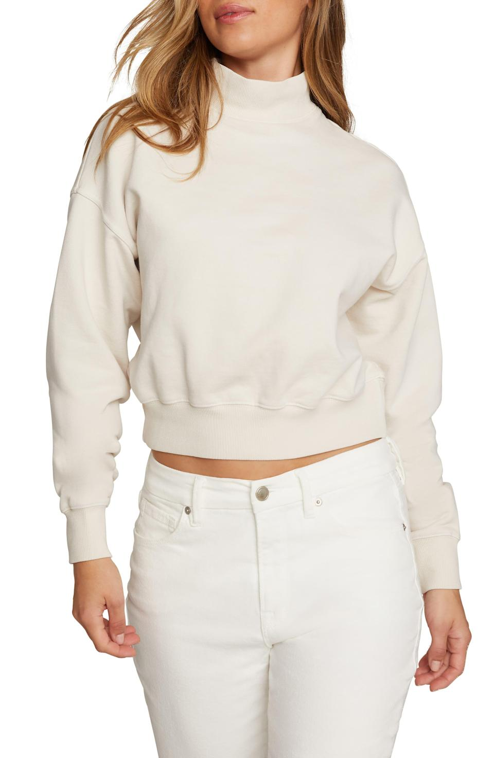"""<p><strong>Good American</strong></p><p>nordstrom.com</p><p><strong>$65.90</strong></p><p><a href=""""https://go.redirectingat.com?id=74968X1596630&url=https%3A%2F%2Fwww.nordstrom.com%2Fs%2Fgood-american-mock-neck-sweatshirt-plus-size%2F5884254&sref=https%3A%2F%2Fwww.womenshealthmag.com%2Flife%2Fg37511825%2Fbest-fall-sweaters%2F"""" rel=""""nofollow noopener"""" target=""""_blank"""" data-ylk=""""slk:Shop Now"""" class=""""link rapid-noclick-resp"""">Shop Now</a></p><p>For some, a full-blown turtleneck can feel a bit restricting. This mock neck extends only a little bit, and it features a wider neckline that's extra roomy. </p><p>The hem on this one is just a <em>tiny</em> bit cropped, so it's perfect for colder temps.</p>"""