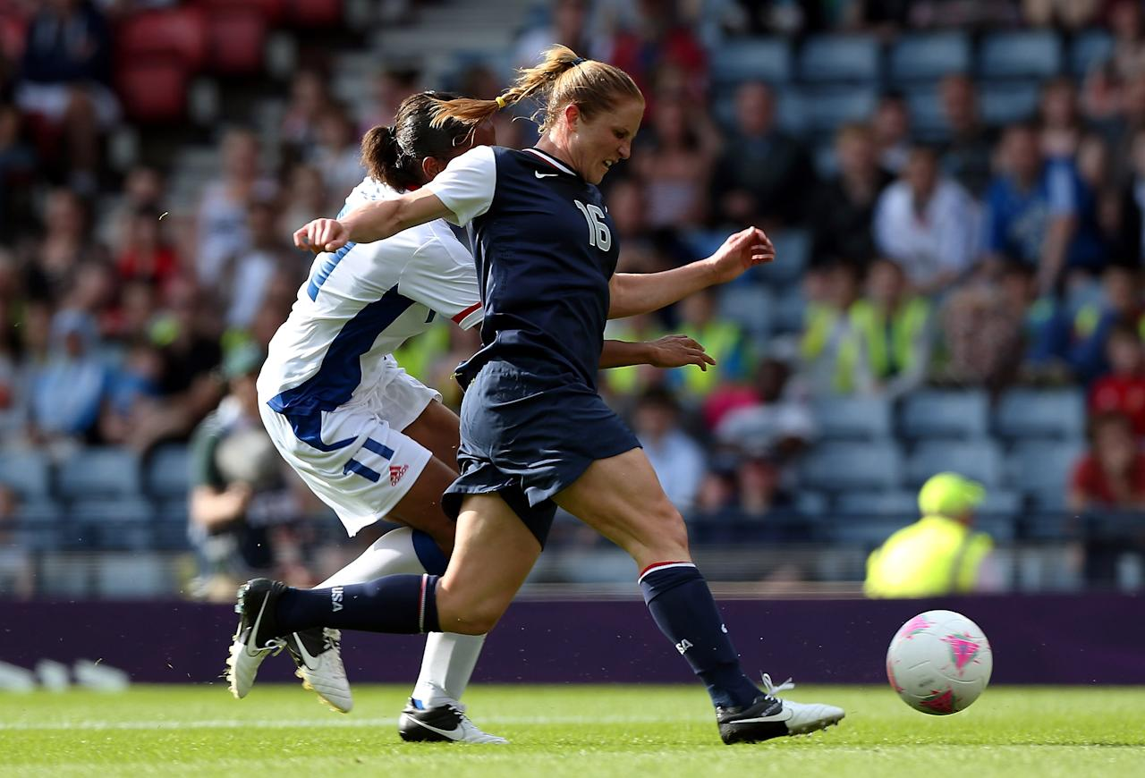 GLASGOW, SCOTLAND - JULY 25:  Rachel Buehler of USA is tackled by Marie-Laure Delie of France during the Women's Football first round Group G Match of the London 2012 Olympic Games between United States and France, at Hampden Park on July 25, 2012 in Glasgow, Scotland.  (Photo by Stanley Chou/Getty Images)