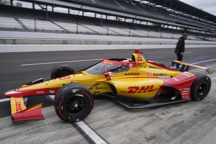 Ryan Hunter-Reay pulls out of the pits during testing at the Indianapolis Motor Speedway, Thursday, April 8, 2021, in Indianapolis. (AP Photo/Darron Cummings)