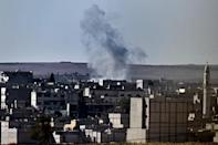 Kurds battle for key Syria town, woman suicide bomber hits IS