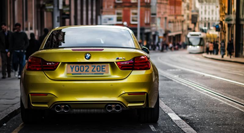 A modern BMW M4 parked in central Nottingham.
