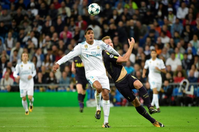 Real Madrid's Raphael Varane (L) vies with Tottenham Hotspur's Harry Kane during their UEFA Champions League group H football match at the Santiago Bernabeu stadium in Madrid on October 17, 2017
