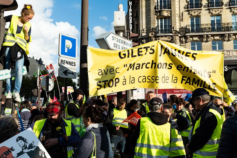 "Yellow Vests demonstrators joined the march to protest against the ""family breakage"" on Sunday, October 6, 2019 where several tens of thousands of people (between 75000 and 600000) responded to the call of the movement ""La Manif Pour Tous"" to participate in Paris in the large mobilization entitled ""Children's Walks"" to protest against the Bioethics law legalizing the PMA (medically assisted reproduction) to homosexual couples. (Photo by Samuel Boivin/NurPhoto via Getty Images)"