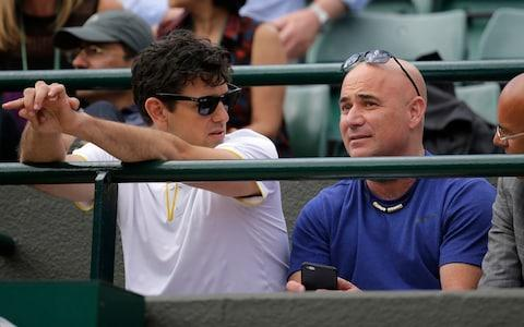 <span>Andre Agassi (R) will continue to work with Djokovic</span>