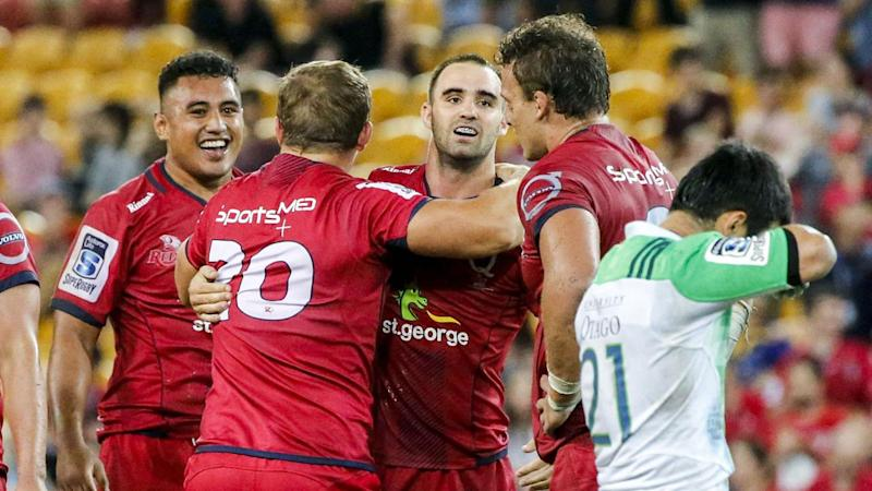 Queensland have held on for their first victory of the Super Rugby season, edging the Highlanders.