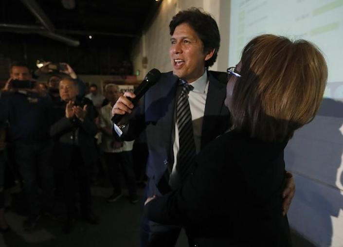 LOS ANGELES, CALIF. -MAR. 3, 2020. L.A. City Council candidate Kevin DeLeon gets a hug from labor leader Maria Elena Durazo at an election night party in Los Angeles on Tuesday night, Mar. 3, 2020. . (Luis Sinco/Los Angeles Times)