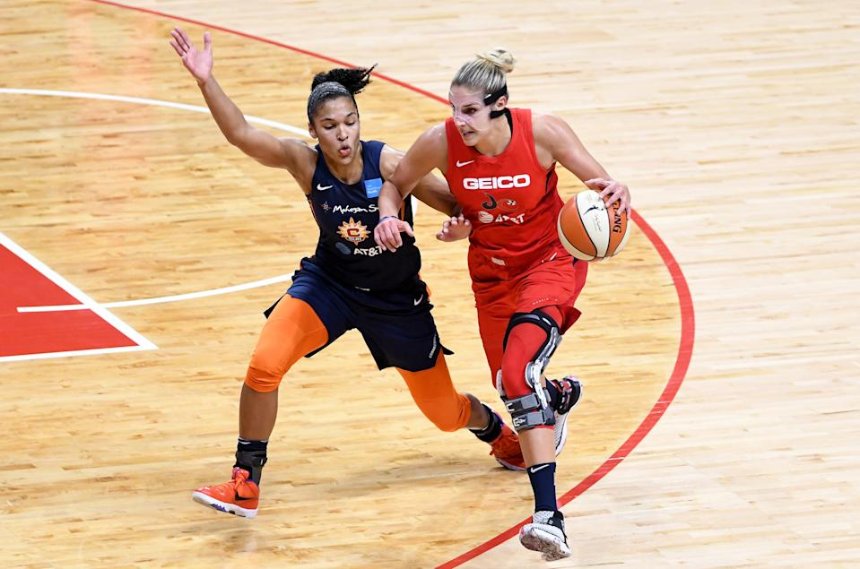 WASHINGTON, DC - OCTOBER 10:  Elena Delle Donne #11 of the Washington Mystics handles the ball against Alyssa Thomas #25 of the Connecticut Sun in Game 5 of the 2019 WNBA Finals at St Elizabeths East Entertainment & Sports Arena on October 10, 2019 in Washington, DC.  (Photo by G Fiume/Getty Images)