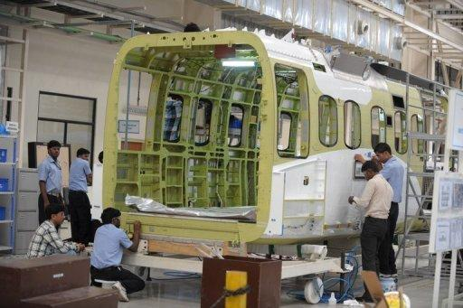 Indian technicians work at a helicopter cabin manufacturing facility in Hyderabad