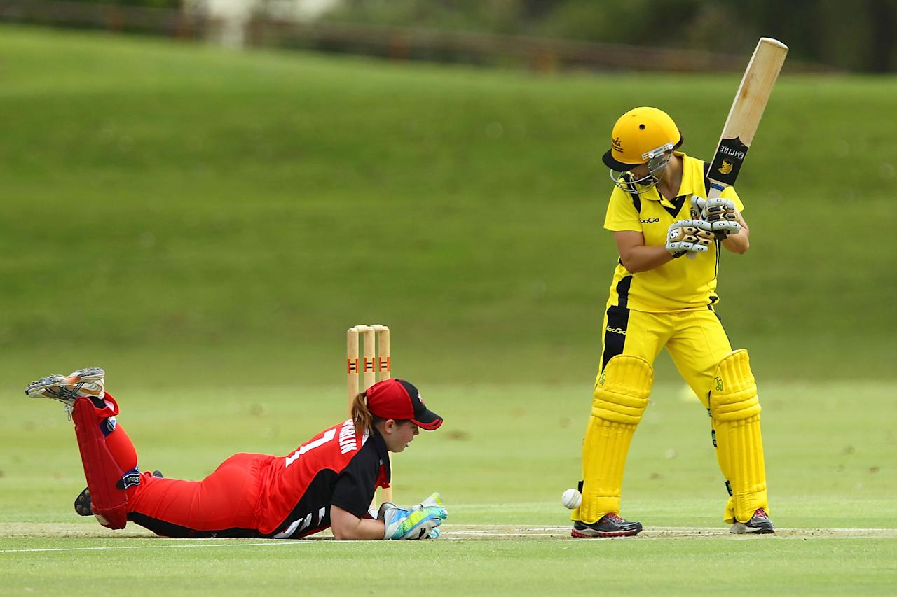 PERTH, AUSTRALIA - DECEMBER 07:  Nicole Bolton of the Fury watches wicketkeeper Tegan McPharlin drop a catch during the Women's Twenty20 match between the Western Australia Fury and the South Australia Scorpions at Christchurch Grammer School on December 7, 2012 in Perth, Australia.  (Photo by Will Russell/Getty Images)