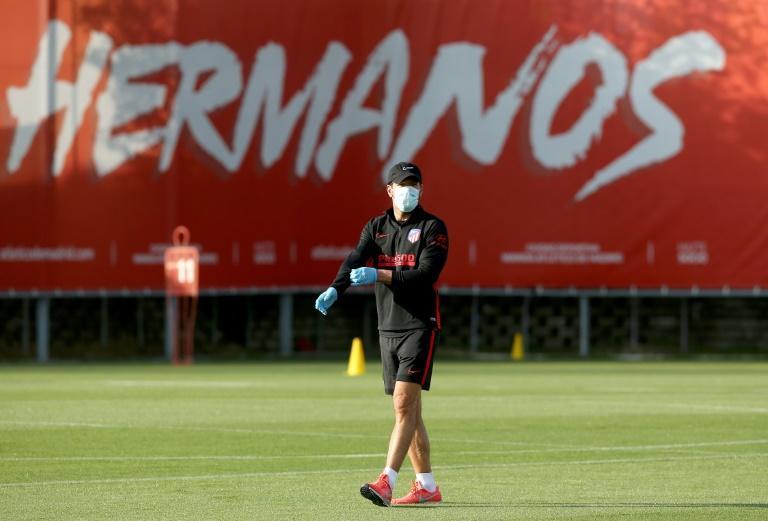 Waiting for the gloves to come off: Atletico Madrid coach Diego Simeone runs a training session