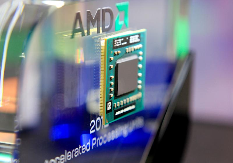 An Advanced Micro Devices Inc. AMD-A10-4600M series APU computer chip is shown at the AMD stand at Computex Taipei 2012 in Taipei, Taiwan, Tuesday, June 5, 2012. Computex Taipei 2012 takes place from June 5 to June 9. Photographer: Ashley Pon / Bloomberg via Getty Images