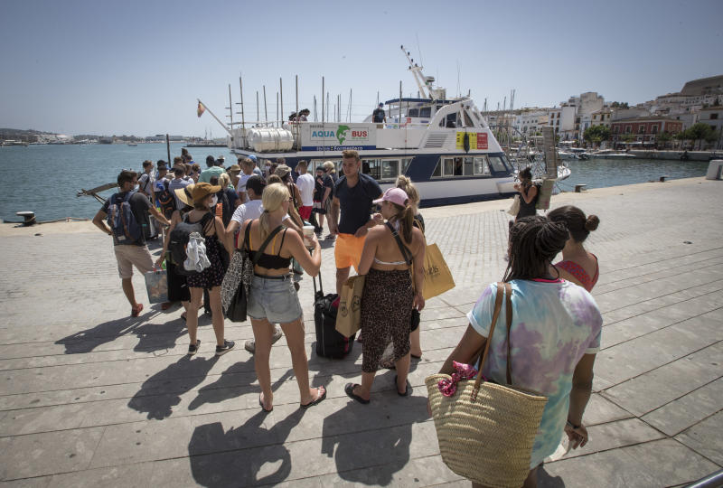 Tourist queue to board a ferry at Ibiza´s harbour, on July 31, 2020. - Spain plunged into recession in the second quarter after its gross domestic product tumbled by 18.5 percent due to the coronavirus pandemic, official figures showed. The business, transport and hotels sector were all badly hit, with a 40 percent drop compared with the first quarter. And tourism, a pillar of the Spanish economy which accounts for 12 percent of GDP, suffered with a 60 percent drop in revenues compared the same period in 2019. (Photo by JAIME REINA / AFP) (Photo by JAIME REINA/AFP via Getty Images)