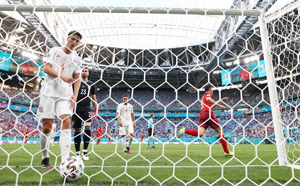 SAINT PETERSBURG, RUSSIA - JULY 02: Pau Torres of Spain collects the ball from the net after the Switzerland first goal scored by Xherdan Shaqiri during the UEFA Euro 2020 Championship Quarter-final match between Switzerland and Spain at Saint Petersburg Stadium on July 02, 2021 in Saint Petersburg, Russia. (Photo by Joosep Martinson - UEFA/UEFA via Getty Images)