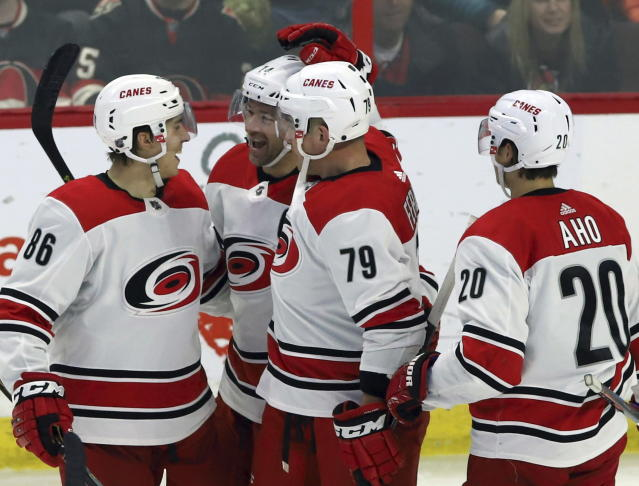 Carolina Hurricanes' Justin Williams (14) celebrates his winning goal against the Ottawa Senators with teammates Teuvo Teravainen (86) Michael Ferland (79) and Sebastian Aho (20) during third-period NHL hockey play in Ottawa, Ontario, Sunday, Jan. 6, 2019. (Fred Chartrand/The Canadian Press via AP)