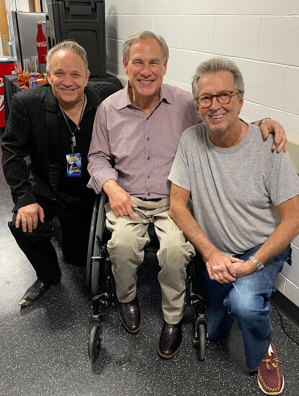 Texas Gov. Greg Abbott (middle), known for his attacks on abortion and voting rights, attended Clapton's recent Austin show. - Credit: Gov. Greg Abbott/Twitter