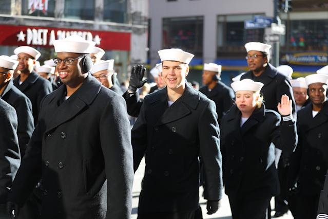 <p>Sailors from the United States Navy wave to crowds during the Veterans Day parade in New York on Nov. 11, 2017. (Photo: Gordon Donovan/Yahoo News) </p>