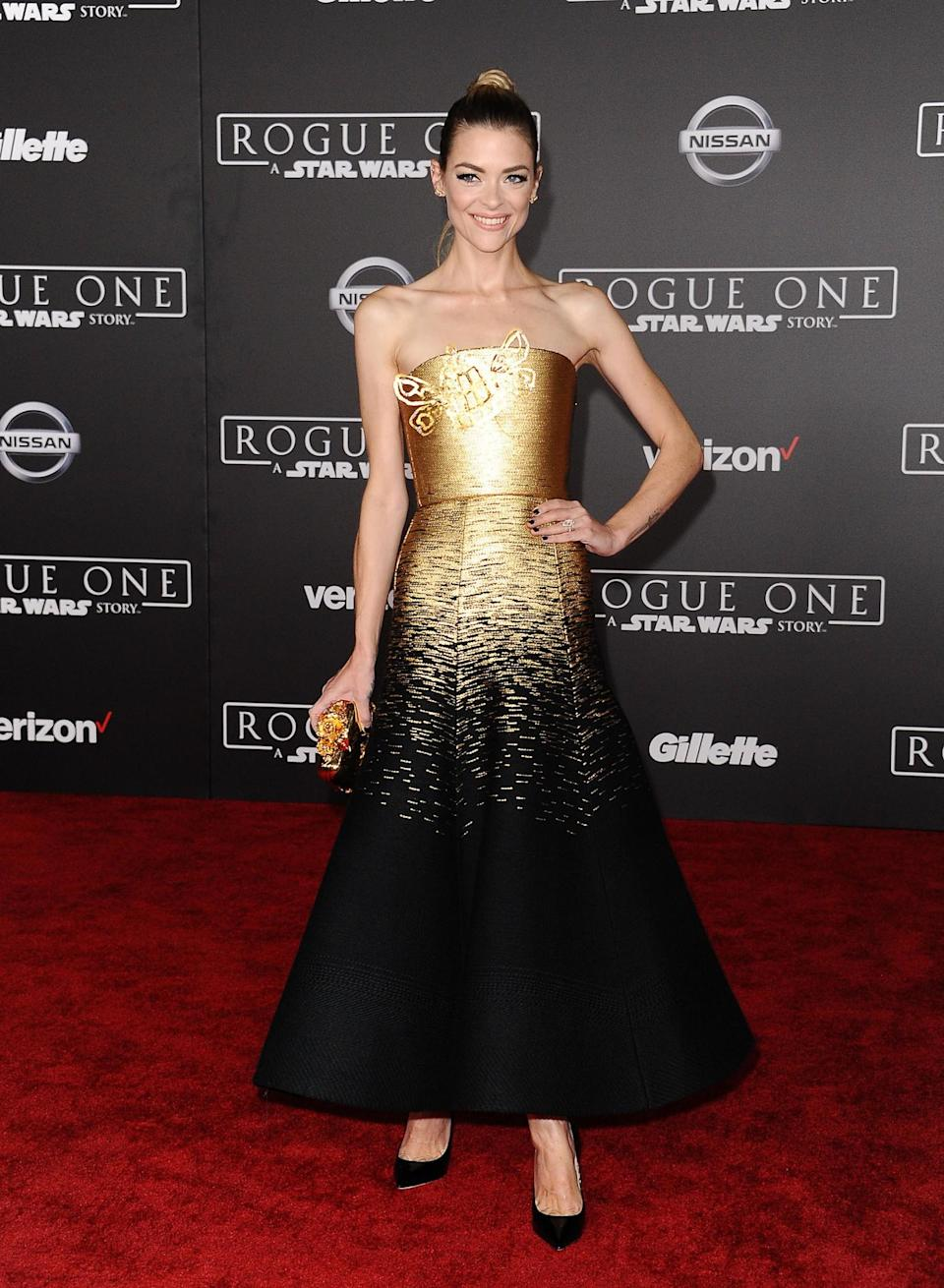 <p>Model-turned-actress Jaime looked incredible in this two-tone, strapless ballgown. Definitely not too dressy for a New Year's Eve house party. [Photo: Getty] </p>