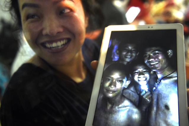<span>A family member smiles after hearing the news that the missing 12 boys and their soccer coach have been found, in Mae Sai, Chiang Rai province, in northern Thailand, Monday, July 2, 2018. A Thai provincial governor says all 12 boys and their coach have been found alive in the cave where they went missing over a week ago in northern Thailand. (AP Photo/Sakchai Lalit)</span>