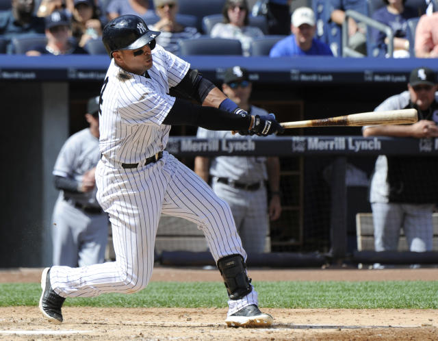 New York Yankees' Martin Prado hits a two-RBI double during the fourth inning of a baseball game against the Chicago White Sox, Saturday, Aug. 23, 2014, at Yankee Stadium in New York. (AP Photo/Bill Kostroun)
