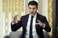 """FILE - In this Monday, March 13, 2017, file photo, Airbnb co-founder and CEO Brian Chesky is interviewed during a luncheon meeting of the Economic Club of New York. The CEO of Airbnb says that the home-sharing company will start offering free housing to 20,000 Afghan refugees globally on Tuesday, Aug. 24, 2021. """"The displacement and resettlement of Afghan refugees in the U.S. and elsewhere is one of the biggest humanitarian crises of our time. We feel a responsibility to step up,"""" Brian Chesky wrote on Twitter. (AP Photo/Richard Drew, FIle)"""