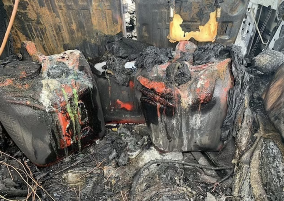 The inside of a Hummer is seen melted after a fire.