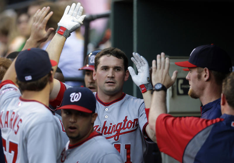 Washington Nationals' Ryan Zimmerman high-fives teammates after hitting a solo home run in the first inning of an interleague baseball game against the Baltimore Orioles, Wednesday, May 29, 2013, in Baltimore. (AP Photo/Patrick Semansky)