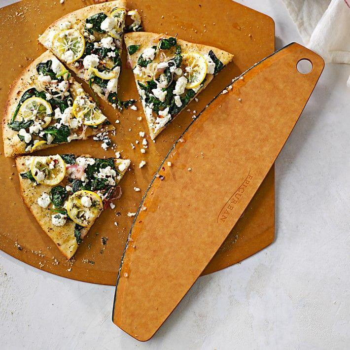 """<p><strong>Williams Sonoma</strong></p><p>williams-sonoma.com</p><p><strong>$19.95</strong></p><p><a href=""""https://go.redirectingat.com?id=74968X1596630&url=https%3A%2F%2Fwww.williams-sonoma.com%2Fproducts%2Fepicurean-pizza-cutter&sref=https%3A%2F%2Fwww.menshealth.com%2Ftechnology-gear%2Fg32270252%2Fcheap-mothers-day-gifts%2F"""" rel=""""nofollow noopener"""" target=""""_blank"""" data-ylk=""""slk:BUY IT HERE"""" class=""""link rapid-noclick-resp"""">BUY IT HERE</a></p><p>If she's a big homemade pizza gal (or flatbread, quesadilla, grilled cheese, etc.) she's going to love this fancy wood-fiber cutter. It turns anyone using it into a kitchen pro for all of those *chef's kiss* moments. </p>"""