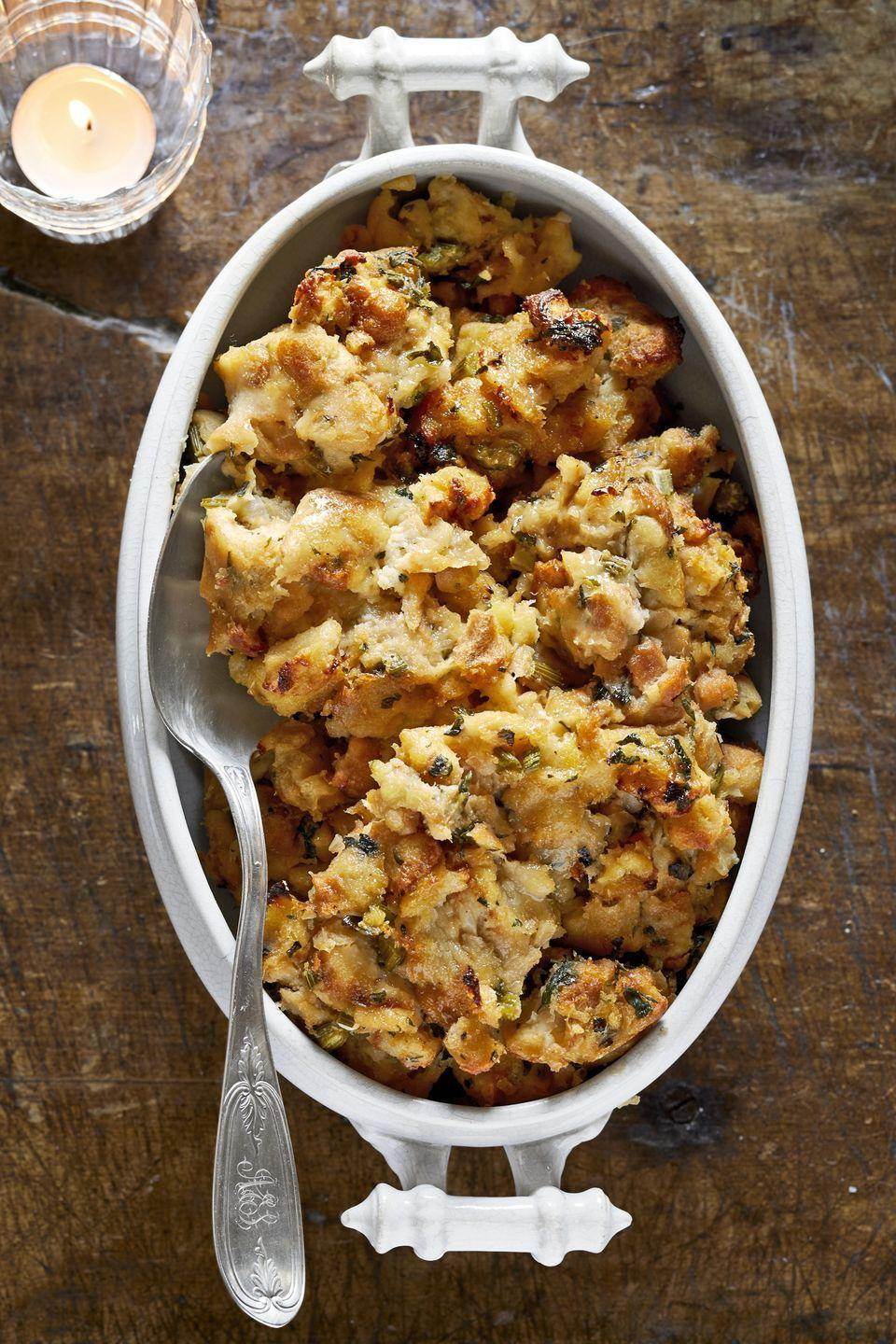"<p>No Thanksgiving table is complete without stuffing. This recipe uses a whole loaf of bread and flavorful herbs—it doesn't get any better than that.</p><p><strong><a href=""https://www.countryliving.com/food-drinks/a29131607/fresh-herb-stuffing/"" rel=""nofollow noopener"" target=""_blank"" data-ylk=""slk:Get the recipe"" class=""link rapid-noclick-resp"">Get the recipe</a>.</strong></p><p><strong><a class=""link rapid-noclick-resp"" href=""https://www.amazon.com/dp/B074Z5X8MT/?tag=syn-yahoo-20&ascsubtag=%5Bartid%7C10050.g.896%5Bsrc%7Cyahoo-us"" rel=""nofollow noopener"" target=""_blank"" data-ylk=""slk:SHOP BAKING DISHES"">SHOP BAKING DISHES</a><br></strong></p>"