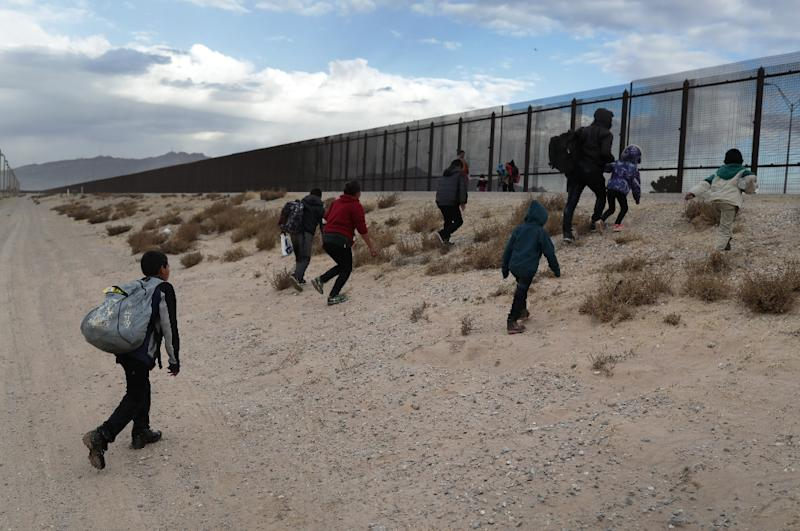 US President Donald Trump says he is determined to build a multi-billion dollar wall along key sections of the US-Mexico border in order to prevent illegal immigrants from crossing into the country (AFP Photo/JOHN MOORE)