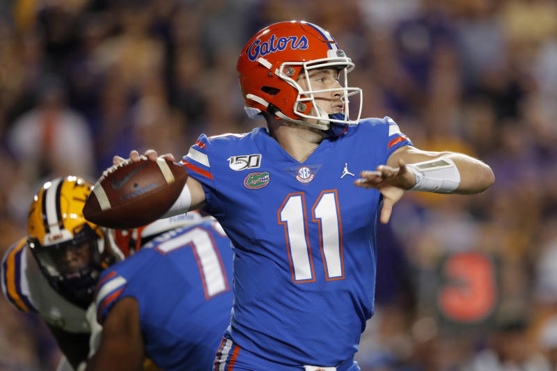 Florida quarterback Kyle Trask (11) passes in the first half of an NCAA college football game against LSU in Baton Rouge, La., Saturday, Oct. 12, 2019. (AP Photo/Gerald Herbert)